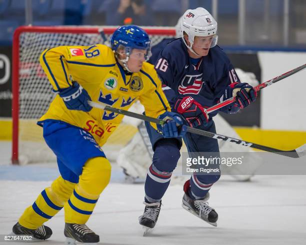 Casey Mittelstadt of the USA battles for position with Rickard Hugg of Sweden during a World Jr Summer Showcase game at USA Hockey Arena on August 2...