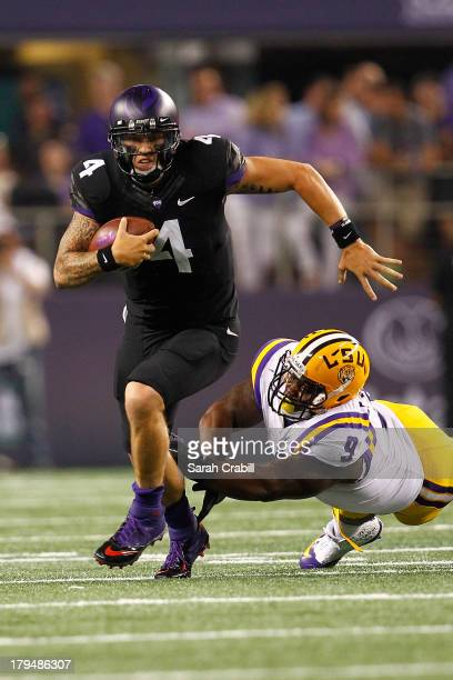 Casey Pachall of the TCU Horned Frogs breaks the tackle of Ego Ferguson of the LSU Tigers during a game at Cowboys Stadium on August 31 2013 in...