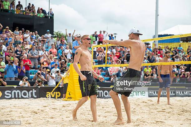 Casey Patterson and Jake Gibb react after winning the Men's Final against Ryan Doherty and Nick Lucena at the 2014 AVP Cincinnati Open on August 31...