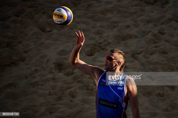 Casey Patterson of the United States catches the ball during the game against Alison Conte Cerutti and Bruno Oscar Schmidt of Brazil during the...