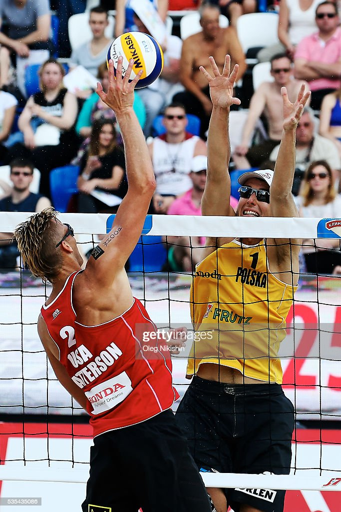 Casey Patterson of USA (L) and Piotr Kantor of Poland duel at the net during a game between USA and Poland on day 6 of the FIVB Moscow Grand Slam at sports complex Dynamo Vodny Stadium on May 29, 2016 in Moscow, Russia.