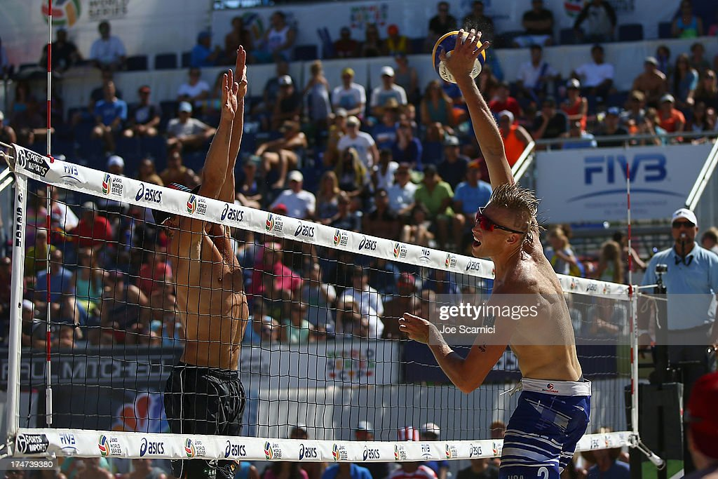 Casey Patterson of USA (R) spikes the ball over <a gi-track='captionPersonalityLinkClicked' href=/galleries/search?phrase=Janis+Smedins&family=editorial&specificpeople=5652150 ng-click='$event.stopPropagation()'>Janis Smedins</a> of Latvia during a men's final match at the ASICS World Series Cup - Day 2 on July 28, 2013 in Long Beach, California.