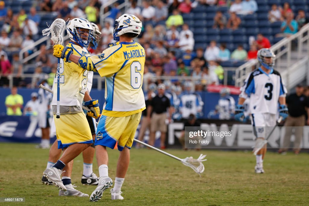 Casey Powell #22 and Kieran McArdle #6 of the Florida Launch celebrate after a goal during the first half of the game against the Ohio Machine at Florida Atlantic University Stadium on May 10, 2014 in Boca Raton, Florida.