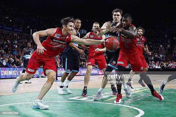 Casey Prather and Casey Prather of the Wildcats go after a loose ball during the round 16 NBL match between the New Zealand Breakers and the Perth...