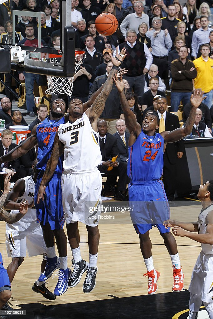 Casey Prather #24 and Patric Young #4 of the Florida Gators rebound the ball against Tony Criswell #3 of the Missouri Tigers during the game at Mizzou Arena on February 19, 2013 in Columbia, Missouri. Missouri upset Florida 63-60.