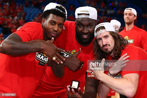 Casey Prather Nate Jawai and Greg Hire of the Wildcats poase with their rings after winning the Championship during game three of the NBL Grand Final...