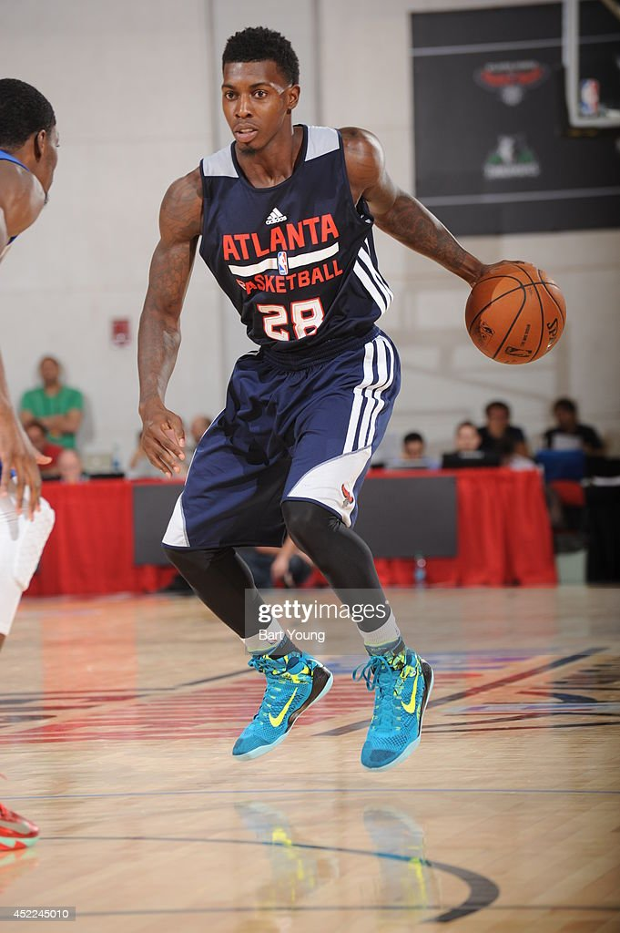 <a gi-track='captionPersonalityLinkClicked' href=/galleries/search?phrase=Casey+Prather&family=editorial&specificpeople=7358715 ng-click='$event.stopPropagation()'>Casey Prather</a> #28 of the Atlanta Hawks dribbles the ball against the Golden State Warriors on July 16, 2014 at the Cox Pavilion in Las Vegas, Nevada.