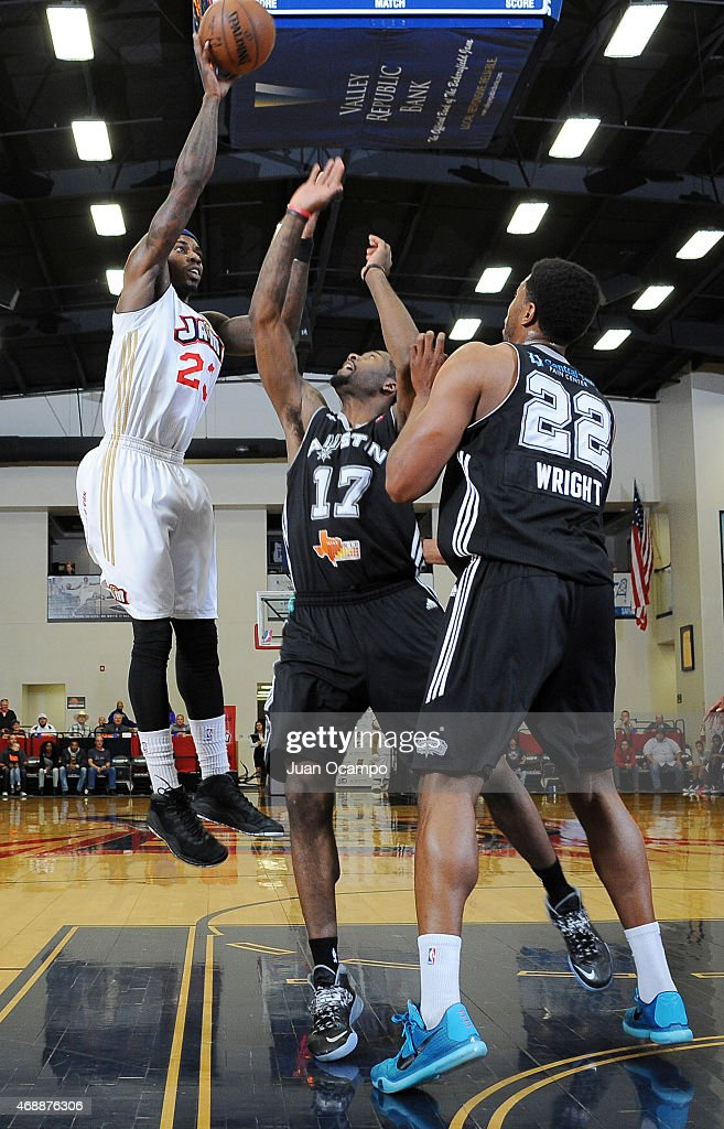 <a gi-track='captionPersonalityLinkClicked' href=/galleries/search?phrase=Casey+Prather&family=editorial&specificpeople=7358715 ng-click='$event.stopPropagation()'>Casey Prather</a> #23 of the Bakersfield Jam shoots over Jonathan Simmons #17 and Keith Wright #22 of the Austin Spurs during Game One of the NBA D-League Western Conference Semifinals on April 7, 2015 at Dignity Health Event Center in Bakersfield, California.
