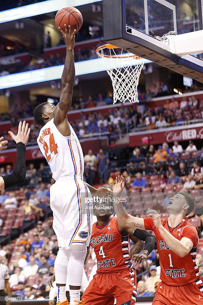 Casey Prather #24 of the Florida Gators goes up against Karachi Edo #4 and <a gi-track='captionPersonalityLinkClicked' href=/galleries/search?phrase=Tyler+Johnson+-+Basketball+Player&family=editorial&specificpeople=14574767 ng-click='$event.stopPropagation()'>Tyler Johnson</a> #1 the Fresno State Bulldogs during the MetroPCS Orange Bowl Basketball Classic on December 21, 2013 at the BB&T Center in Sunrise, Florida.