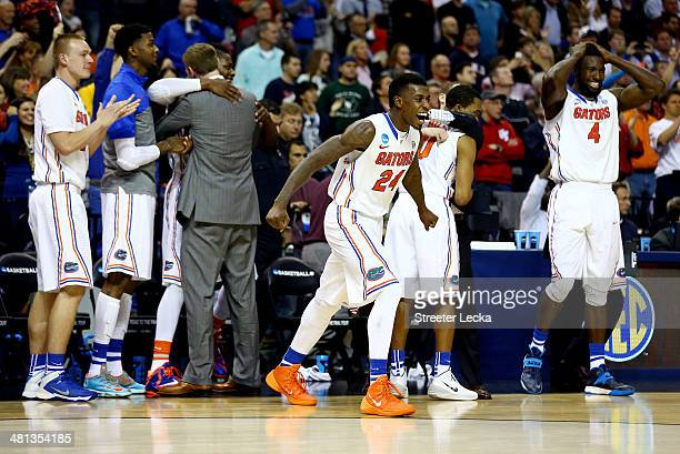 Casey Prather of the Florida Gators runs onto the court after defeating the Dayton Flyers 6252 in the south regional final of the 2014 NCAA Men's...