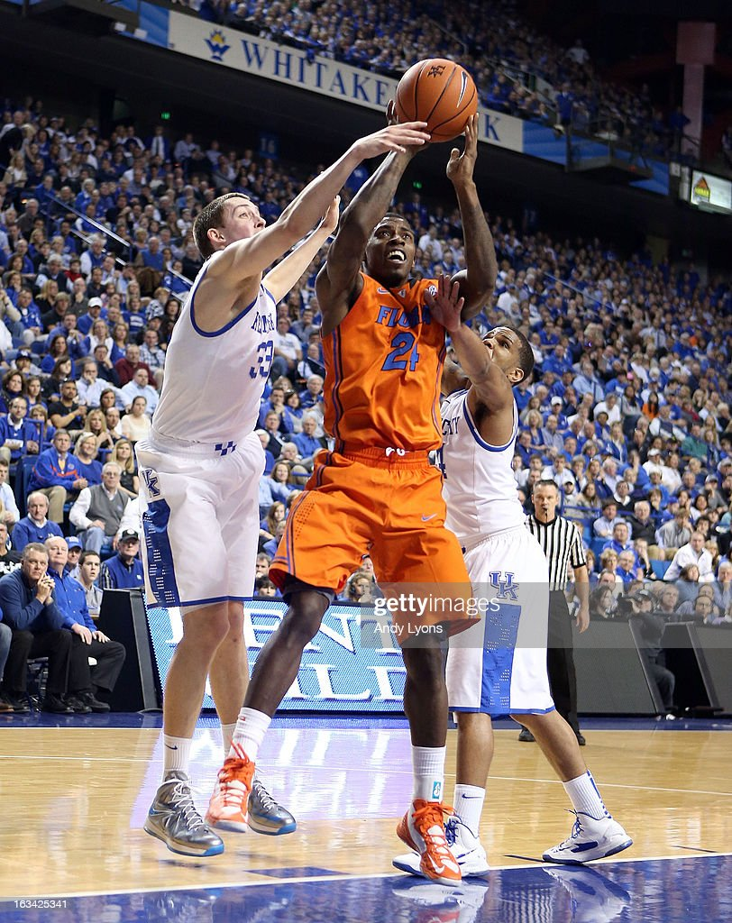Casey Prather #24 of the Florida Gators shoots the ball while defended by Kyle Wiltjer #33 and Julius Mays #34 of the Kentucky Wildcats during the game at Rupp Arena on March 9, 2013 in Lexington, Kentucky.