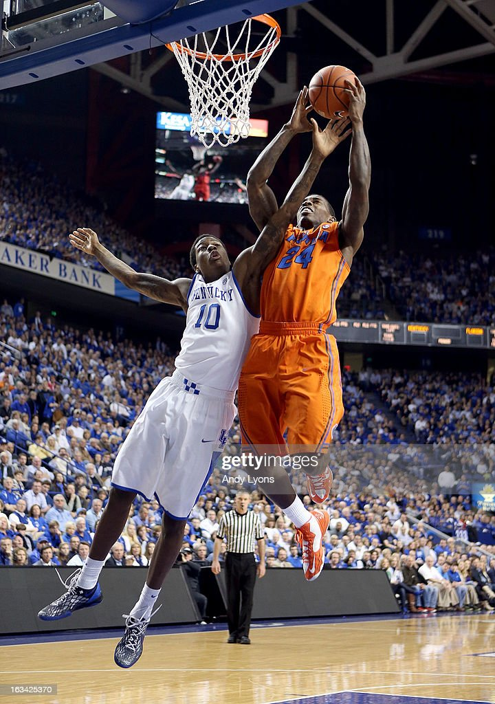 Casey Prather #24 of the Florida Gators shoots the ball while defended by <a gi-track='captionPersonalityLinkClicked' href=/galleries/search?phrase=Archie+Goodwin&family=editorial&specificpeople=9086088 ng-click='$event.stopPropagation()'>Archie Goodwin</a> #10 of the Kentucky Wildcats during the game at Rupp Arena on March 9, 2013 in Lexington, Kentucky.