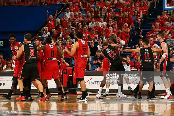 Casey Prather of the Wildcats and Andrew Ogilvy of the Hawks are separated by team mates during the NBL Semi Final match between Perth Wildcats and...