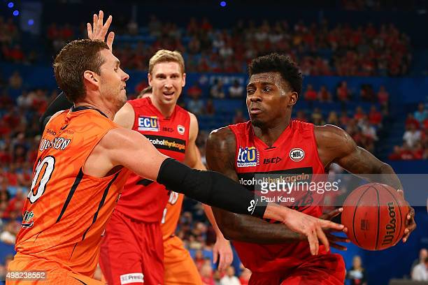 Casey Prather of the Wildcats drives to the basket against Alex Loughton of the Taipans during the round seven NBL match between the Perth Wildcats...