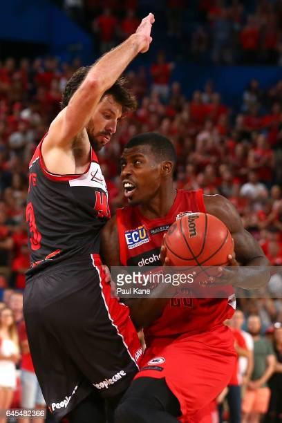 Casey Prather of the Wildcats drives to the basket against Kevin White of the Hawks during game one of the NBL Grand Final series between the Perth...
