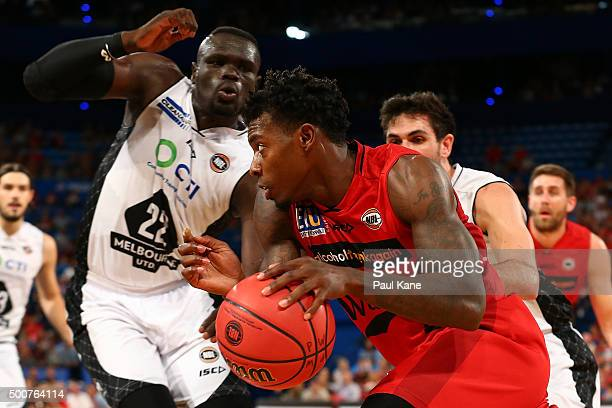 Casey Prather of the Wildcats drives to the basket against Majok Majok of United during the round 10 NBL match between the Perth Wildcats and...