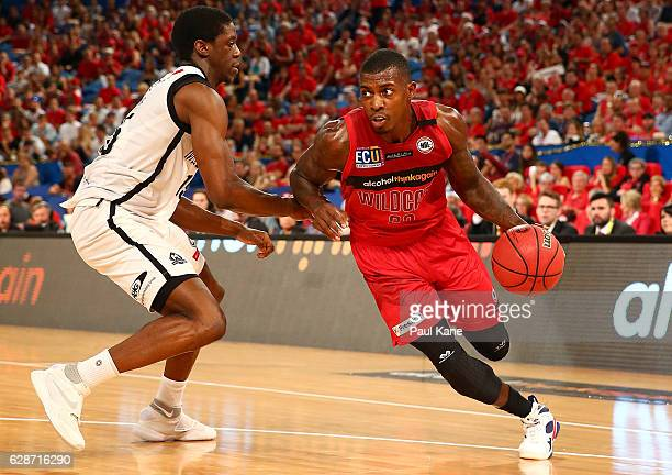Casey Prather of the Wildcats drives to the basket against Owen Odigie of United during the round 10 NBL match between the Perth Wildcats and...