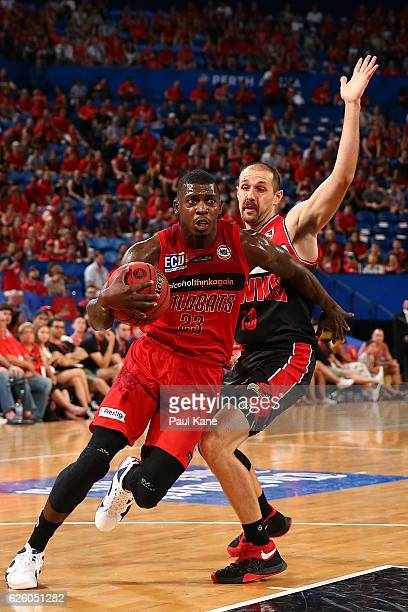Casey Prather of the Wildcats drives to the basket against Rhys Martin of the Hawks during the round eight NBL match between the Perth Wildcats and...