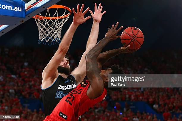Casey Prather of the Wildcats lays up against Alex Pledger of the Breakers during game three of the NBL Grand Final series between the Perth Wildcats...