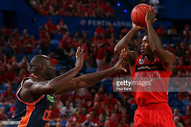 Casey Prather of the Wildcats looks to shoot against Nathan Jawai of the Taipans during the round 16 NBL match between the Perth Wildcats and the...