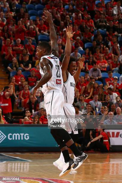 Casey Prather of United celebrates a 3 point shot on the half time buzzer with Casper Ware during the round three NBL match between the Perth...