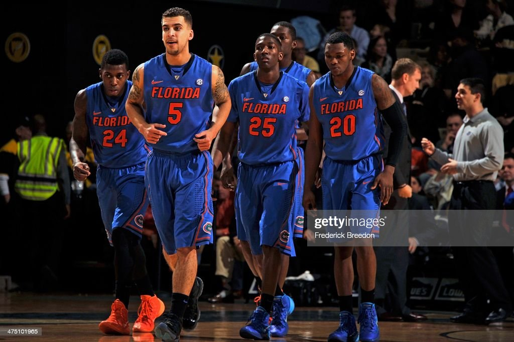 Casey Prather Scottie Wilbekin DeVon Walker and Michael Frazier II of the Florida Gators play against the Vanderbilt Commodores at Memorial Gym on...