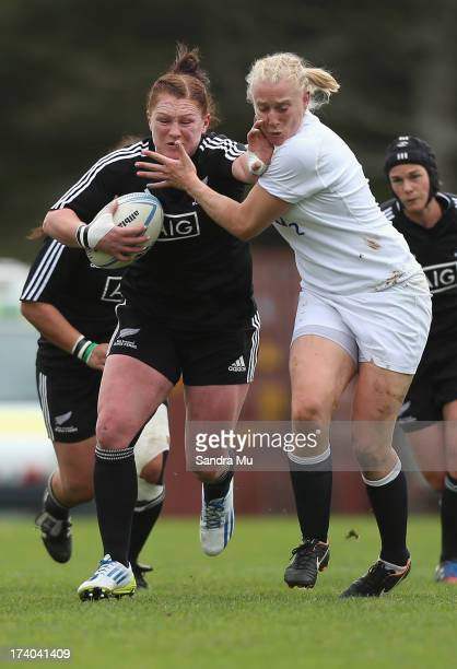 Casey Robertson of the Black Ferns fends off Tamara Taylor of England during game 3 of the international series between the New Zealand Black Ferns...