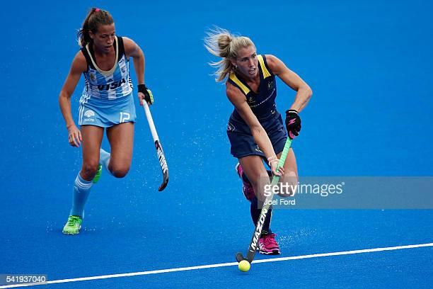 Casey Sablowski of Australia goes past Delfina Merino of Argentina during the FIH Women's Hockey Champions Trophy 2016 match between Australia and...