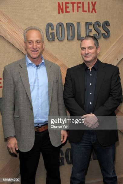 Casey Silver and Scott Frank attend 'Godless' New York premiere at The Metrograph on November 19 2017 in New York City