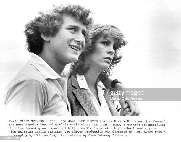 Casey Stevens puts an arm around Jamie Lee Curtis in a scene from the film 'Prom Night' 1980