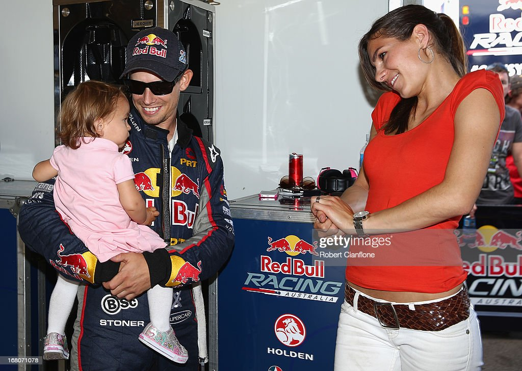Casey Stoner driver of the Red Bull Pirtek Holden is seen with his wife Adriana and baby daughter Alessandra Maria prior to round two of the V8...