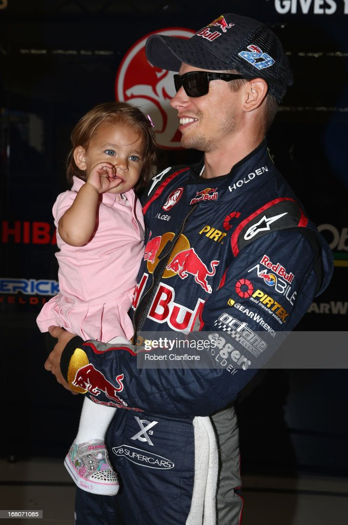 Casey Stoner driver of the #27 Red Bull Pirtek Holden is seen with his daughter Alessandra Maria prior to round two of the V8 Supercars Dunlop Development Series at Barbagallo Raceway on May 5, 2013 in Perth, Australia.