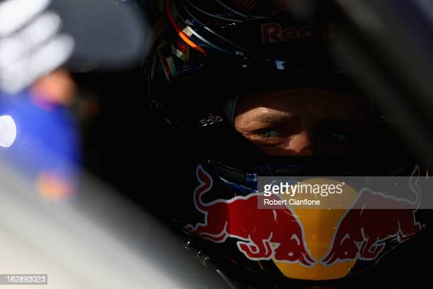 Casey Stoner driver of the Red Bull Pirtek Holden sits in his car prior to race one of round one of the V8 Supercars Dunlop Development Series at the...