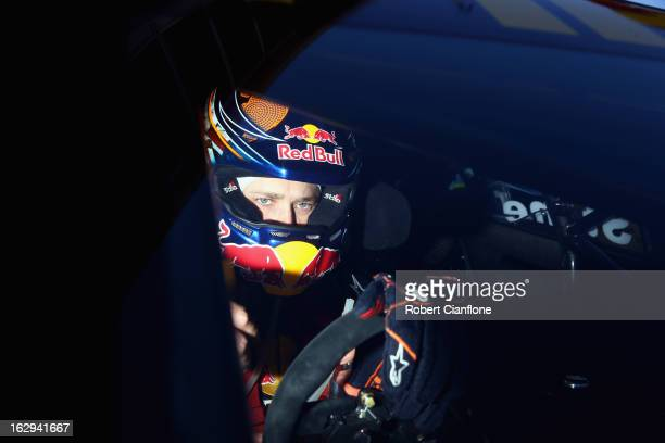Casey Stoner driver of the Red Bull Pirtek Holden sits in his car prior to race two for round one of the V8 Supercars Dunlop Development Series at...