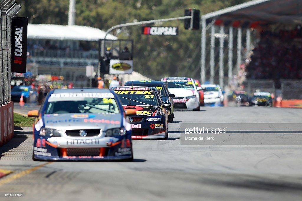 Casey Stoner (2L) drives the #27 Red Bull Pirtek Holden during race two of the V8 Supercars Dunlop Development Series at the Adelaide Street Circuit on March 1, 2013 in Adelaide, Australia.
