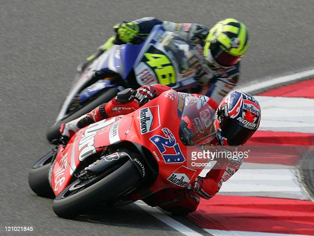 Casey Stoner of Australia and Ducati Marlboro team and Valentino Rossi of Italy and Fiat Yamaha team in action during the Motorcycle Grand Prix of...
