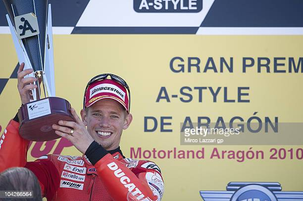 Casey Stoner of Australia and Ducati Marlboro Team celebrates the victory on the podium at the end of MotoGP race of MotoGP of Aragon at Motorland...