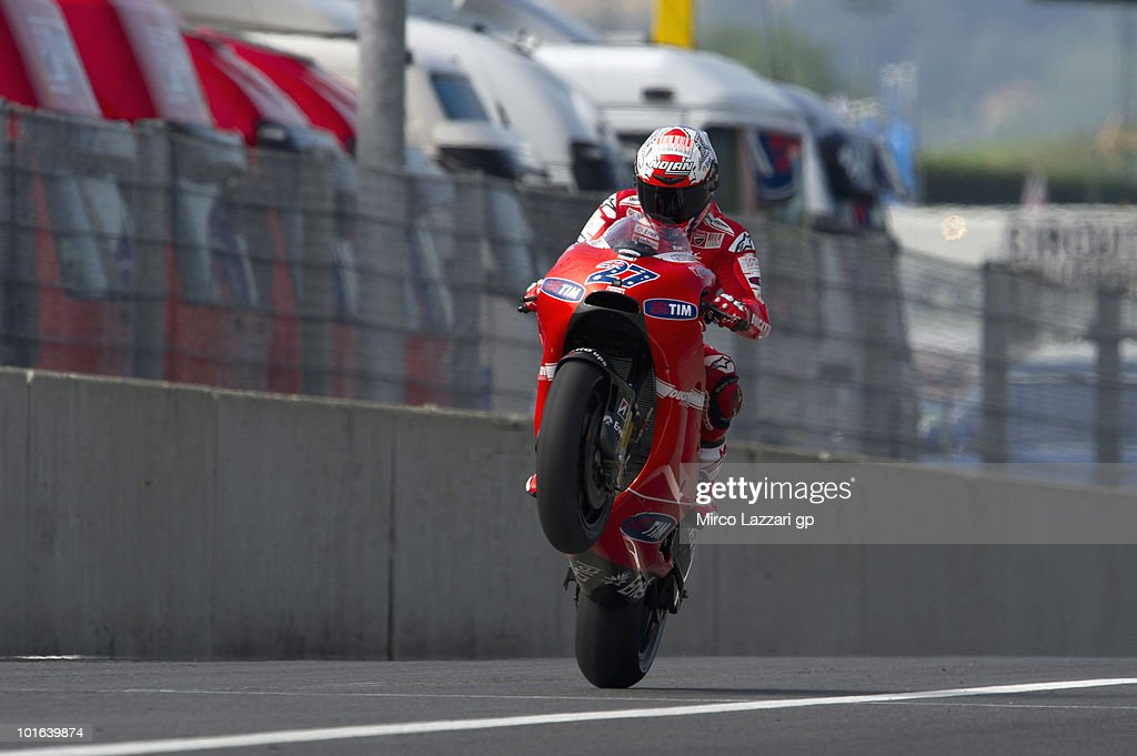 Casey Stoner of Australia and Ducati Marlboro Team lifts the front wheel at the end of second free practice of the Grand Prix of Italy on June 5, 2010 in Mugello Circuit near Florence, Italy.