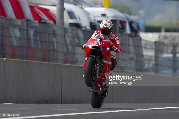 Casey Stoner of Australia and Ducati Marlboro Team lifts the front wheel at the end of second free practice of the Grand Prix of Italy on June 5 2010...