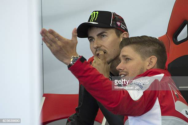 16 Casey Stoner of Australia and Ducati Team speaks with Jorge Lorenzo of Spain and Ducati Team in box during the MotoGp Tests In Valencia at Ricardo...