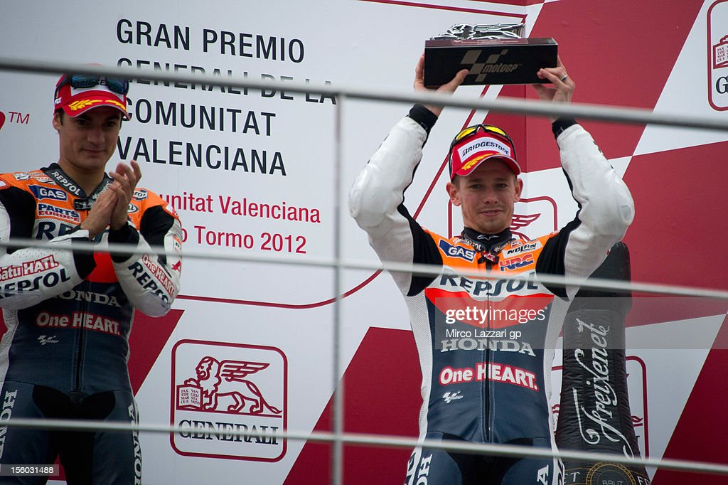 Casey Stoner of Australia and Repsol Honda Team (R) and Dani Pedrosa of Spain and Repsol Honda Team celebrate on the podium at the end of the MotoGP race of the MotoGP of Valencia at Ricardo Tormo Circuit on November 11, 2012 in Valencia, Spain.