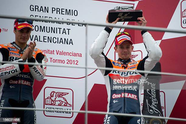 Casey Stoner of Australia and Repsol Honda Team and Dani Pedrosa of Spain and Repsol Honda Team celebrate on the podium at the end of the MotoGP race...