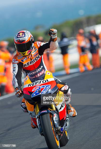 Casey Stoner of Australia and Repsol Honda Team celebrates after winning the race and the championship at the Australian MotoGP which is round 16 of...