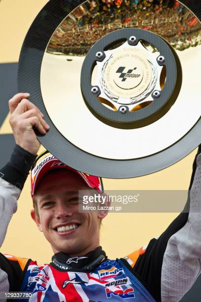 Casey Stoner of Australia and Repsol Honda Team celebrates on the podium after winning the race and the championship at the Australian MotoGP which...