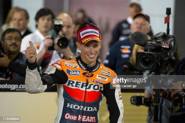 Casey Stoner of Australia and Repsol Honda Team celebrates the victory under the podium at the end of MotoGP race of MotoGP of Qatar at Losail...