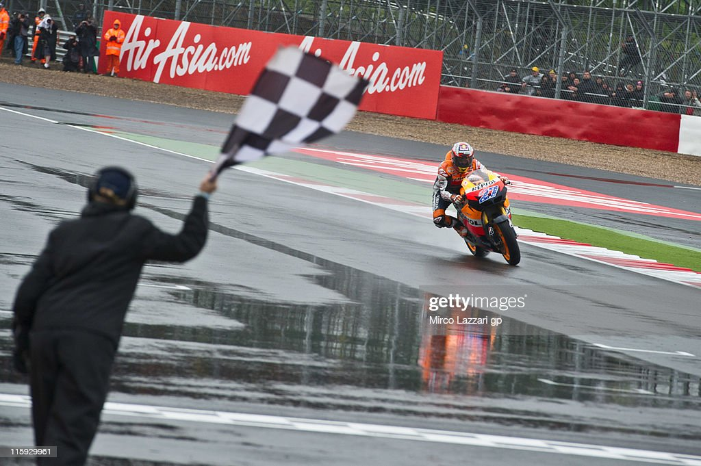 Casey Stoner of Australia and Repsol Honda Team cuts the finish line and celebrates the victory at the end of the MotoGP race of MotoGp Of Great Britain at Silverstone Circuit on June 12, 2011 in Northampton, England.