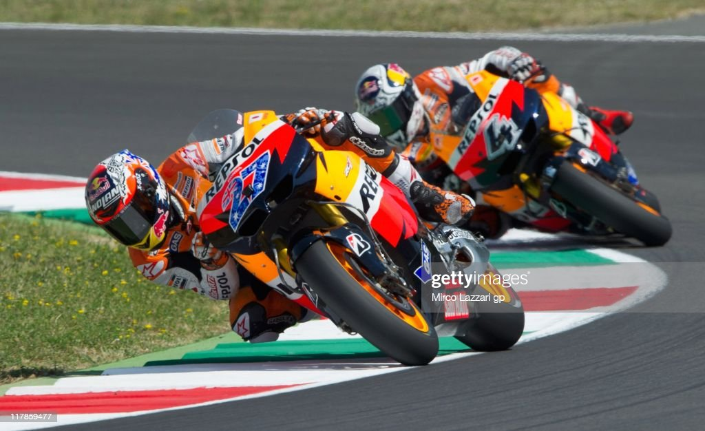 <a gi-track='captionPersonalityLinkClicked' href=/galleries/search?phrase=Casey+Stoner&family=editorial&specificpeople=563465 ng-click='$event.stopPropagation()'>Casey Stoner</a> (L) of Australia and Repsol Honda Team leads <a gi-track='captionPersonalityLinkClicked' href=/galleries/search?phrase=Andrea+Dovizioso&family=editorial&specificpeople=559970 ng-click='$event.stopPropagation()'>Andrea Dovizioso</a> of Italy and Repsol Honda Team during the free practice of MotoGp of Italy at Mugello Circuit on July 1, 2011 in Scarperia near Florence, Italy.