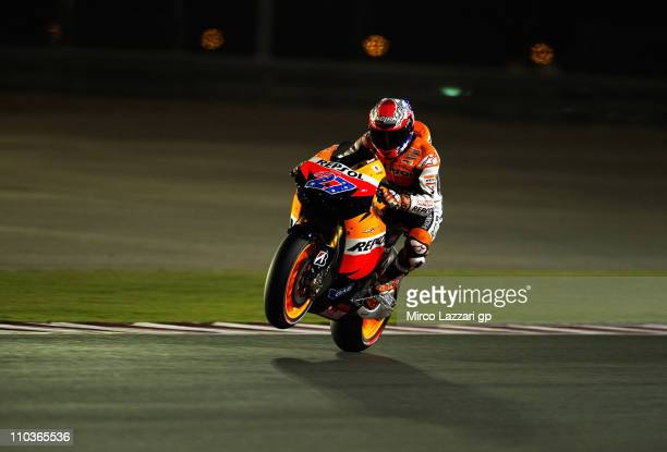 Casey Stoner of Australia and Repsol Honda Team lifts the front wheel during the free practice of Doha GP at Losail Circuit on March 17 2011 in Doha...