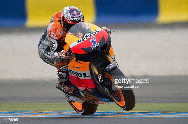 Casey Stoner of Australia and Repsol Honda Team lifts the front wheel during the qualifying practice of the MotoGp Of France on May 19 2012 in Le...