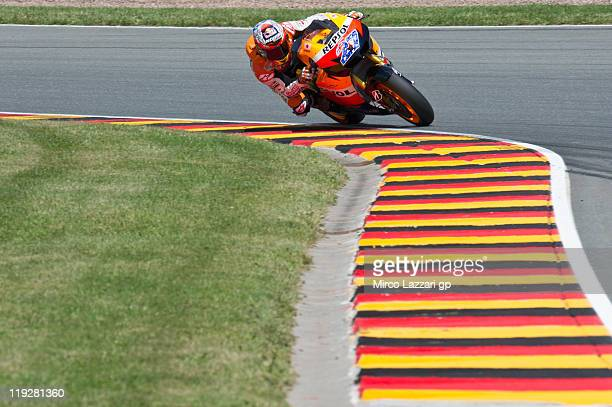 Casey Stoner of Australia and Repsol Honda Team rounds the bend during the qualifying practice of MotoGP of Germany at Sachsenring Circuit on July 16...